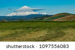 mt hood with a lenticular cloud | Shutterstock . vector #1097556083