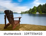 muskoka chair sitting on a wood ... | Shutterstock . vector #1097556410