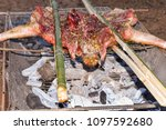 barbecued suckling pig very... | Shutterstock . vector #1097592680