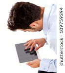 Business man using tablet computer - isolated over a white background - stock photo