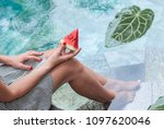 a girl holds a water melon in... | Shutterstock . vector #1097620046