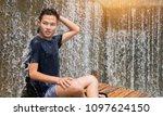 asian smart young man  sitting...   Shutterstock . vector #1097624150