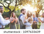 bride and groom dancing at... | Shutterstock . vector #1097633639
