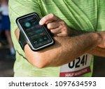 senior runner using a fitness... | Shutterstock . vector #1097634593