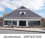 Small photo of April 19, 2018 - Woodbury Commons Premium Outlets, NY. Adidas outlet store featuring the brand's signature athletic footwear, clothes & accessories.