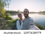 young couple taking a selfie... | Shutterstock . vector #1097638979