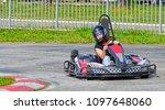 woman driving go kart . speed... | Shutterstock . vector #1097648060