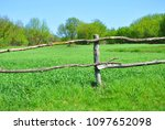 old wooden fence on the... | Shutterstock . vector #1097652098