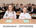 happy schoolchildren sit at a... | Shutterstock . vector #1097656406