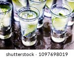 alcohol. tequila shot with lime ... | Shutterstock . vector #1097698019