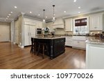 Stock photo kitchen in luxury home with white cabinetry 109770026
