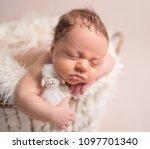 sleeping newborn baby boy | Shutterstock . vector #1097701340