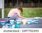 pretty boy on the ground... | Shutterstock . vector #1097702393
