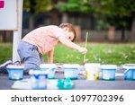 creative child making artwork... | Shutterstock . vector #1097702396