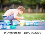 little child sitting on the... | Shutterstock . vector #1097702399
