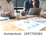 business people analyzing... | Shutterstock . vector #1097703284