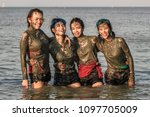 girls dirty with mud. beauty... | Shutterstock . vector #1097705009