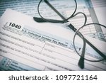 us tax form and glasses....   Shutterstock . vector #1097721164