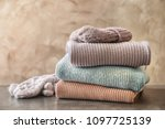 stack of warm knitted clothes... | Shutterstock . vector #1097725139