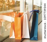 close up shopping bags on the...   Shutterstock . vector #1097739344