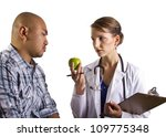 Doctor suggesting diet - stock photo