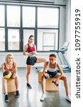 three multicultural sportswomen ... | Shutterstock . vector #1097755919