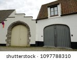 old arch garage and gate with... | Shutterstock . vector #1097788310