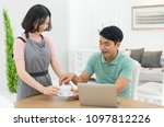 asian couple at home using a... | Shutterstock . vector #1097812226