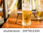 glass of cold beer at terrace | Shutterstock . vector #1097812334