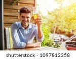 relax after work. young smart... | Shutterstock . vector #1097812358