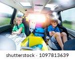 holidays   siblings arguing in... | Shutterstock . vector #1097813639