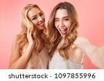 two pretty young women taking a ... | Shutterstock . vector #1097855996