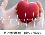 doctor pushing button heart... | Shutterstock . vector #1097870399