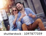 happy young couple having fun... | Shutterstock . vector #1097877359