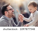 father and son having fun in... | Shutterstock . vector #1097877548