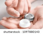 woman holding contact lens and... | Shutterstock . vector #1097880143