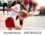 Women play basketball. group of ...