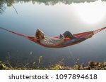 young man by the lake hanging...   Shutterstock . vector #1097894618