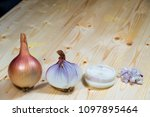 Small photo of side view of white wooden table with a onion in one piece, cut on a half, two circles of a onion, and small pieces of a cuts, different types of cuttings