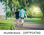 couple exercise walking in the... | Shutterstock . vector #1097914760