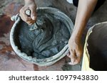 mixing cement with the bucket... | Shutterstock . vector #1097943830