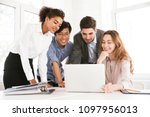 Group of smart young multiethnic businesspeople discussing ideas while looking at laptop computer