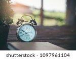 retro alarm clock placed on... | Shutterstock . vector #1097961104