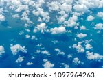 aerial view of clouds and blue...