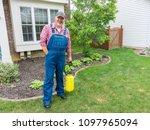 property owner or gardener with ... | Shutterstock . vector #1097965094