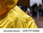 yellow raincoat rain jacket.... | Shutterstock . vector #1097973080