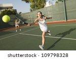 Tennis Player Hitting A Shot...
