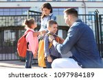 young parents saying goodbye to ... | Shutterstock . vector #1097984189
