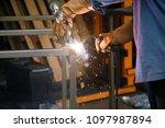 welding. a welder arc welds... | Shutterstock . vector #1097987894