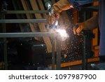 welding. a welder arc welds... | Shutterstock . vector #1097987900